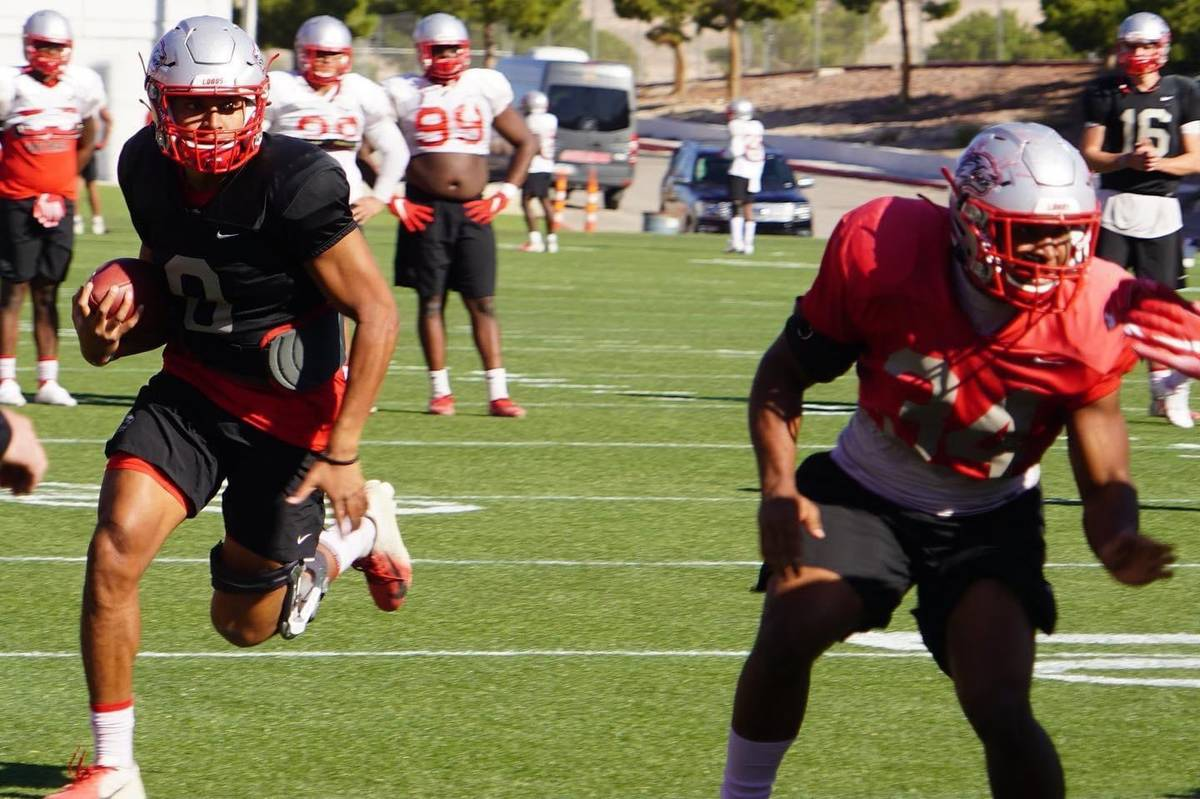 Quarterback Tevaka Tuioti, left, and the New Mexico football team have switched their home base ...