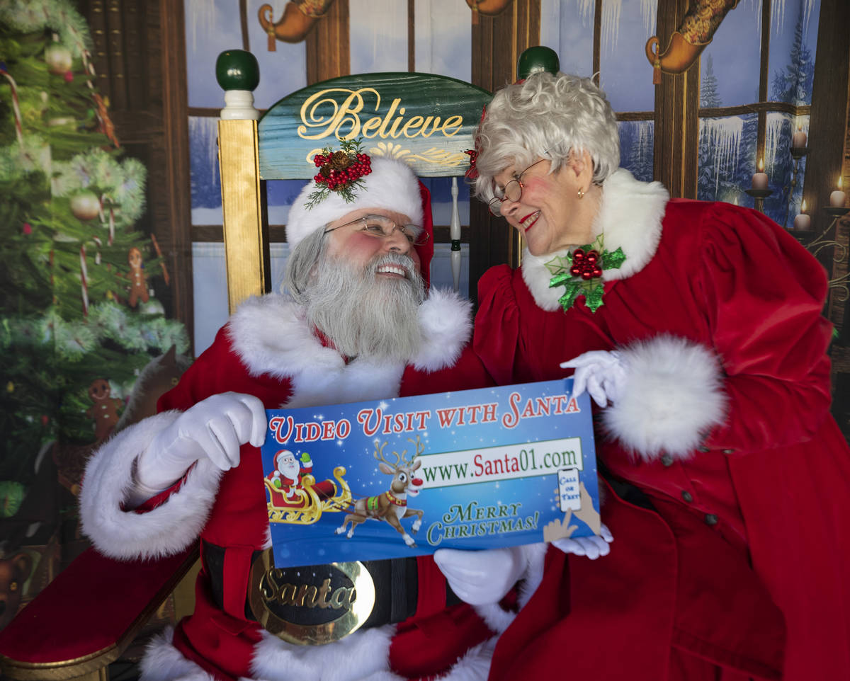 """Chris Groeschke, 64, left, and Nancy Jean Gray, 72, as """"Santa Kris Kringle"""" and Mrs. Claus, are ..."""