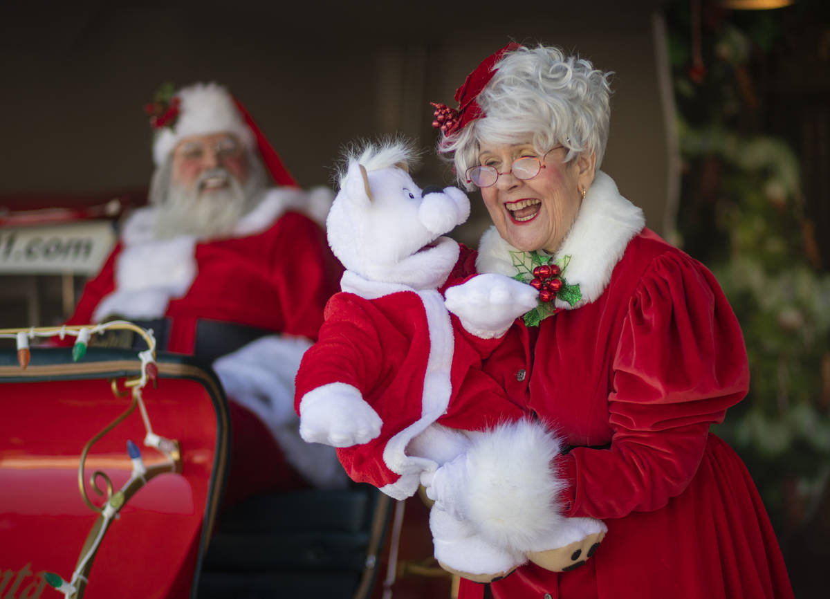 "Chris Groeschke, 64, left, and Nancy Jean Gray, 72, as ""Santa Kirs Kringle"" and Mrs. ..."