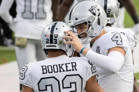 Las Vegas Raiders quarterback Derek Carr (4) celebrates a touchdown run by Las Vegas Raiders ru ...