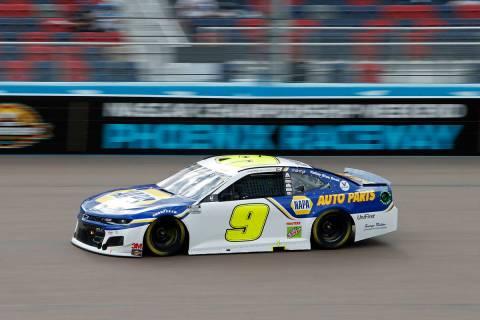 Chase Elliott (9) races through Turn 4 during the NASCAR Cup Series auto race at Phoenix Racewa ...