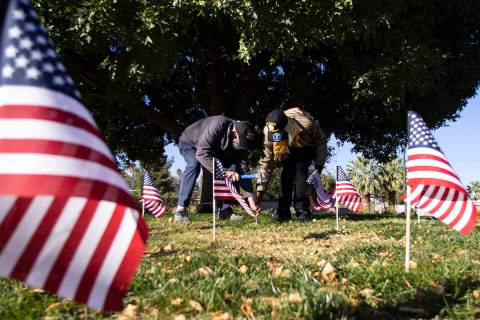 Gordon Woodward, retired U.S. Army corporal, left, and retired U.S. Air Force Lt. Col. Christin ...