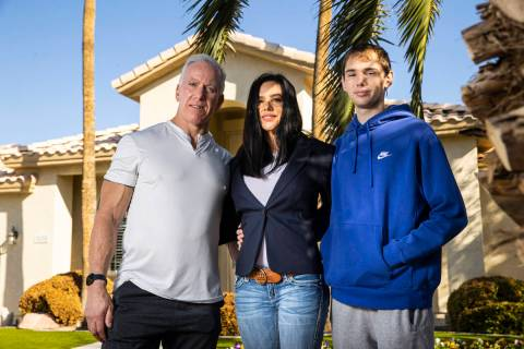 Danielle Wood, center, poses with her husband, Brian, and son, Nate, 17, at their home in Las V ...