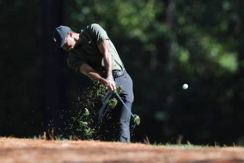 Tiger Woods tees off on the 11th hole during the first round of the Masters golf tournament Thu ...