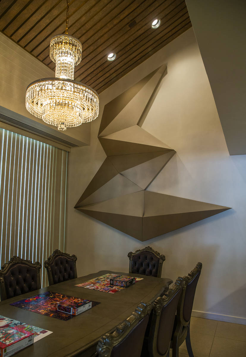 A Bill Arms sculpture piece hangs in the dining room during a tour of Lefty Rosenthal's former ...