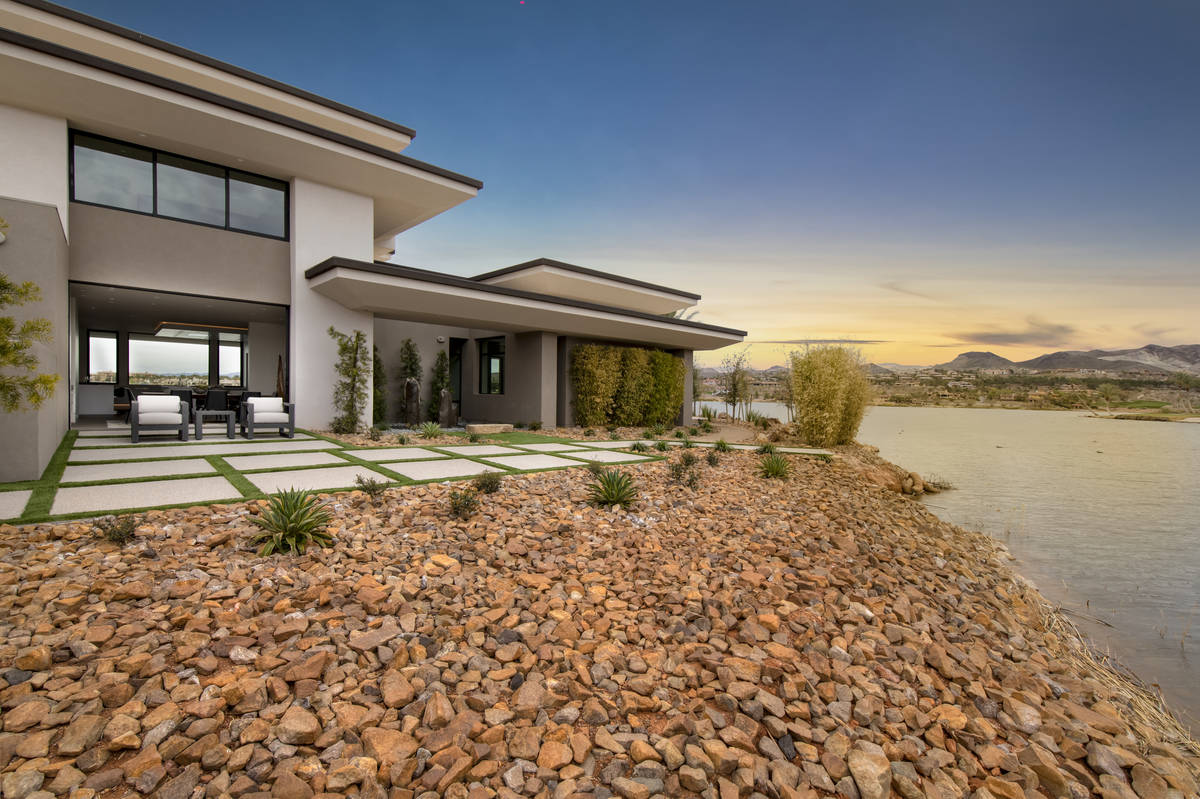 This two-story, 8,838-square-foot Lake Las Vegas custom home was built by the community's man-m ...