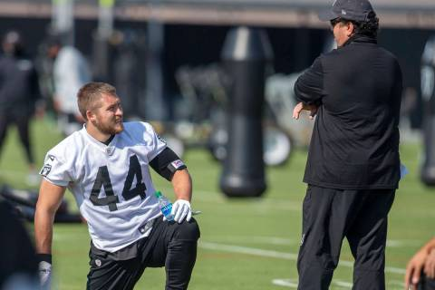 Las Vegas Raiders inside linebacker Nick Kwiatkoski (44) speaks to defensive coordinator Paul G ...