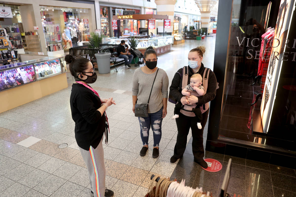 Nola Woodfin, her son Patrick, 5 months, and friend Tomi Guzman, all of Las Vegas, prepare to s ...