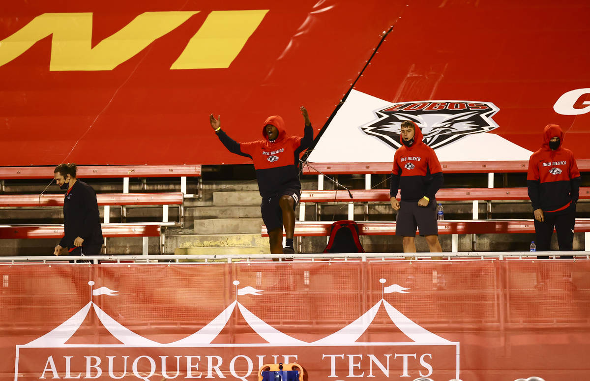 New Mexico Lobos players cheer as they play UNR during the second half of a football game at Sa ...