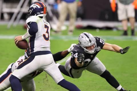 Las Vegas Raiders defensive end Carl Nassib (94) pressures Denver Broncos quarterback Drew Lock ...