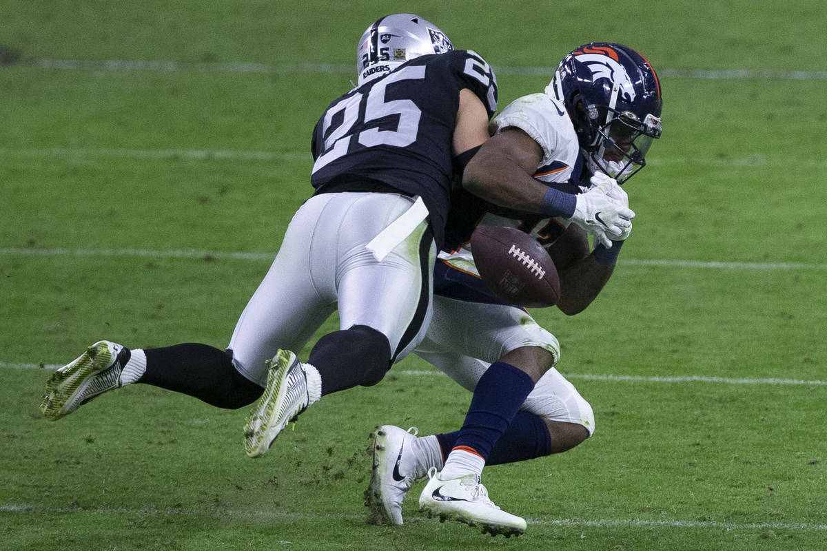 Las Vegas Raiders free safety Erik Harris (25) forces the football out of the hands of Denver B ...
