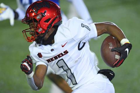 UNLV's Kyle Williams carries against San Jose State during the first quarter of an NCAA college ...