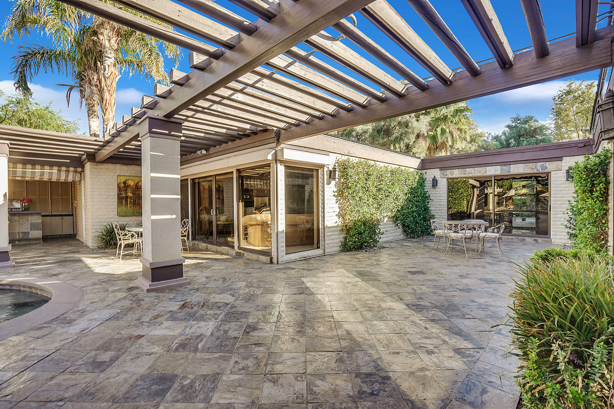 A private backyard oasis features a resort-style pool with spa and expansive pool deck. Right o ...