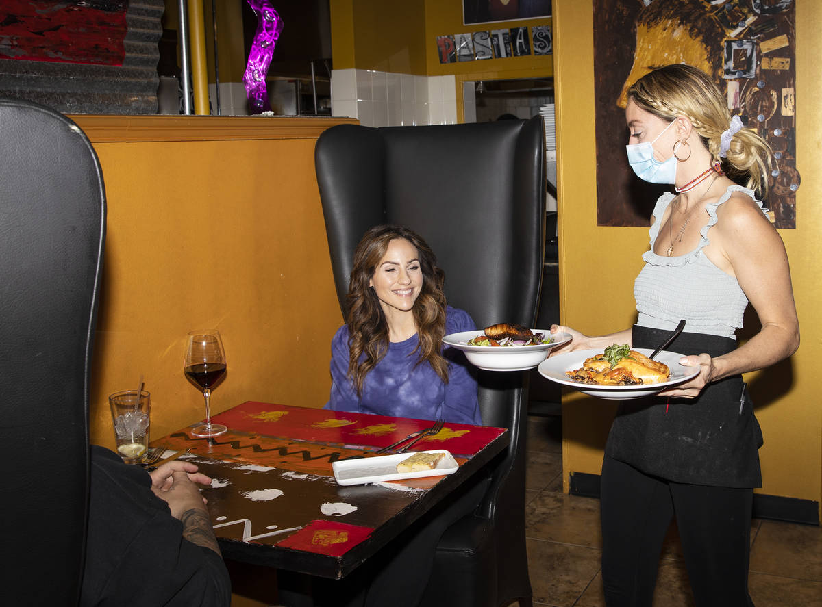 Bianca Alenik serves food to Dana DeCarlo and her husband Mike Arthur at Pasta Shop Ristorante ...