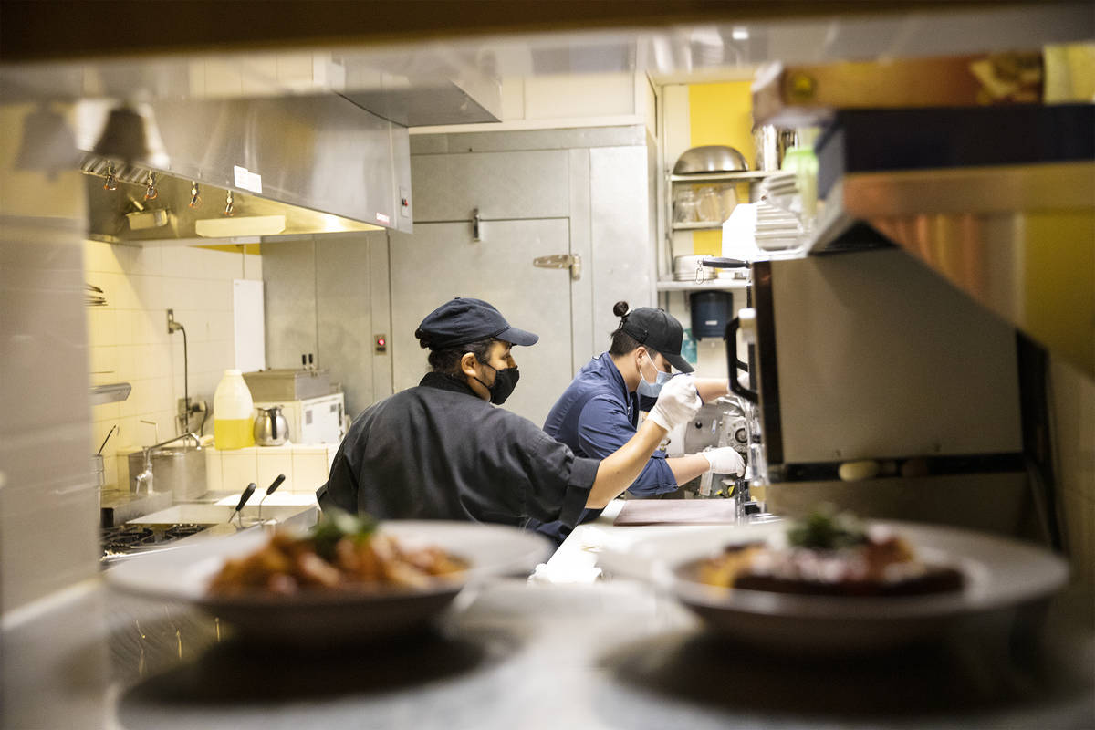 Chef Denise Ortiz, left, and Chef Omar Velazquez, right, cook for the dinner rush at Pasta Shop ...