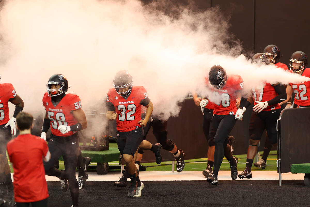 UNLV Rebels take the field for their game against Fresno State Bulldogs during in the NCAA foot ...