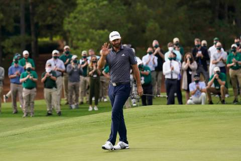 Dustin Johnson waves after winning the Masters golf tournament Sunday, Nov. 15, 2020, in August ...