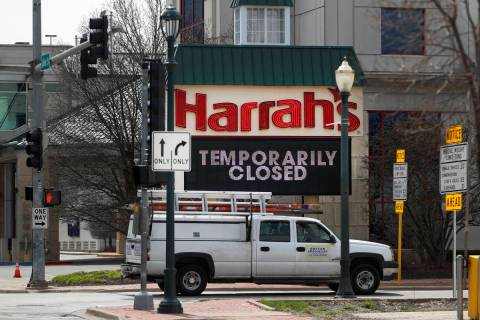 A marquee sign reminds residents of Joliet, Ill., that Harrah's Casino on the Des Plaines River ...