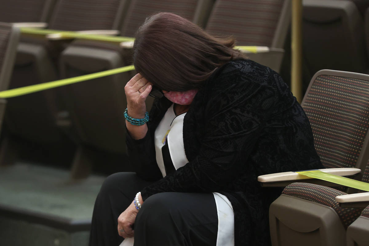 Lisa Baxter lowers her head during the fact finding review in the death of her son David Baxter ...