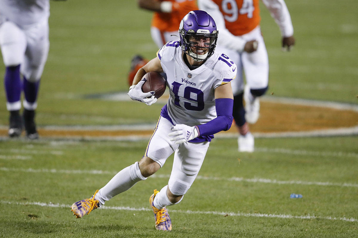 Minnesota Vikings wide receiver Adam Thielen (19) runs with the ball during the first half of a ...