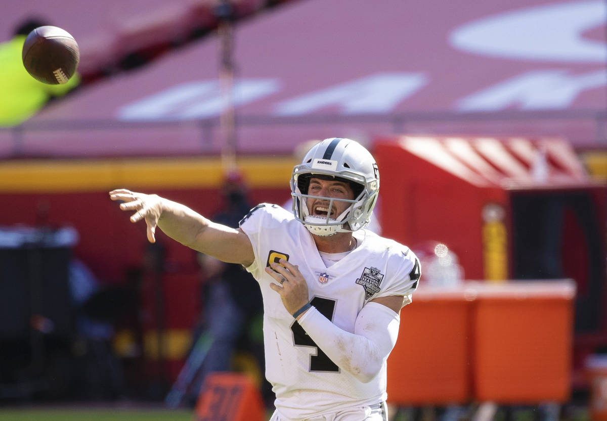 Las Vegas Raiders quarterback Derek Carr (4) makes a sideline pass in the fourth quarter during ...