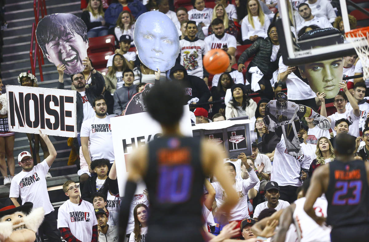 UNLV fans try to distract a Boise State Broncos player during the first half of a basketball ga ...