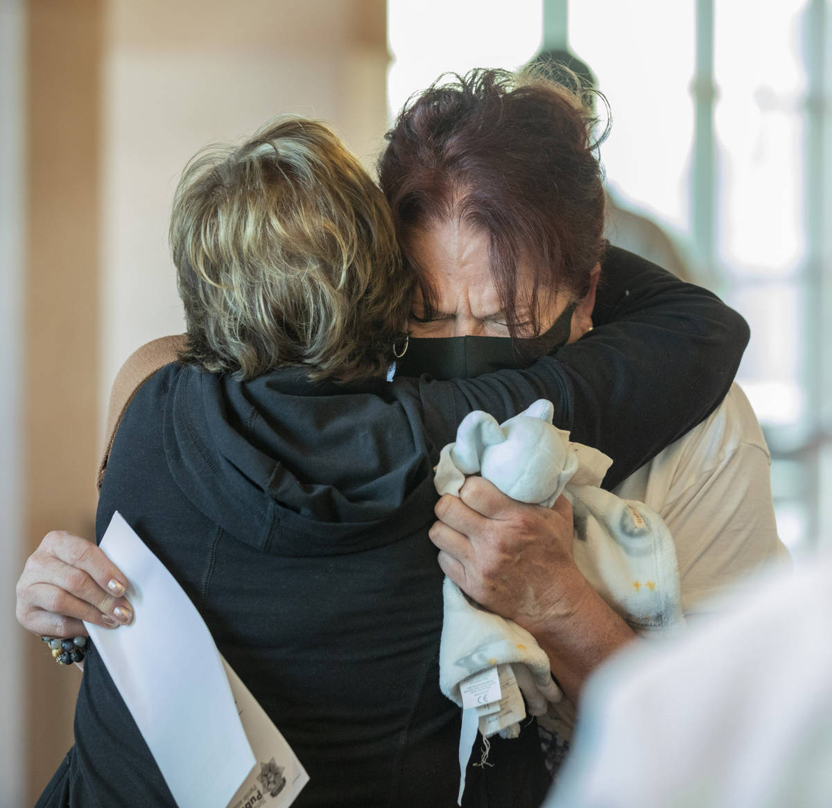 Lauren Prescia's grandmother Lois Prescia, left, and mother Kelly Nyman, hug after Lauren Presc ...