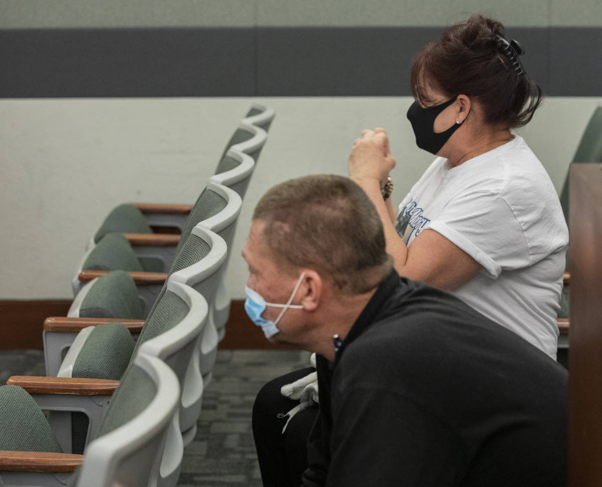 John Prescia, left, and Kelly Nyman, parents of defendant Lauren Prescia, watch their daughter ...