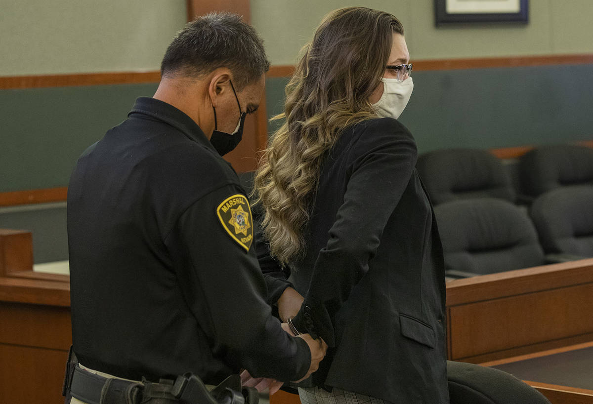 Lauren Prescia is escorted out of the courtroom after receiving her sentencing for the death of ...