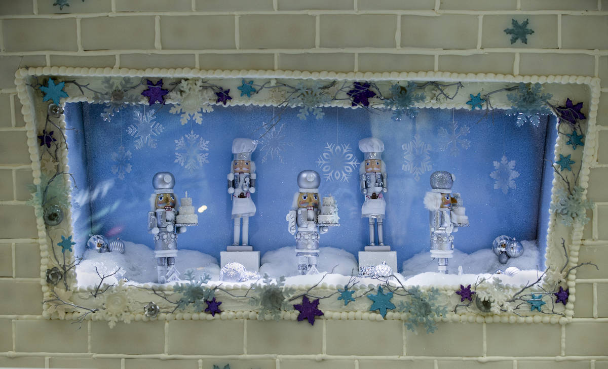 Nutcrackers spin in a picture window at Aria's Sugar Palace lobby display unveiled today in Las ...