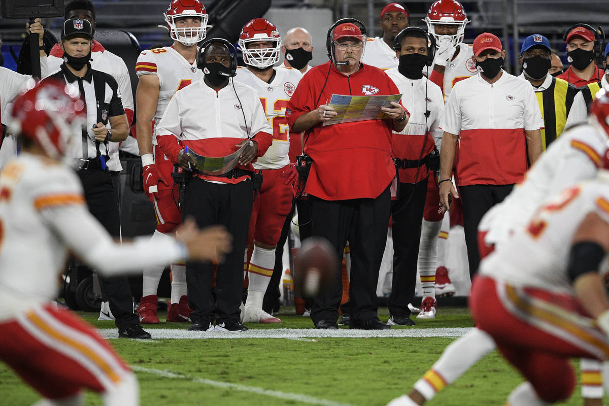 Kansas City Chiefs head coach Andy Reid watches his team during the first half of an NFL footba ...