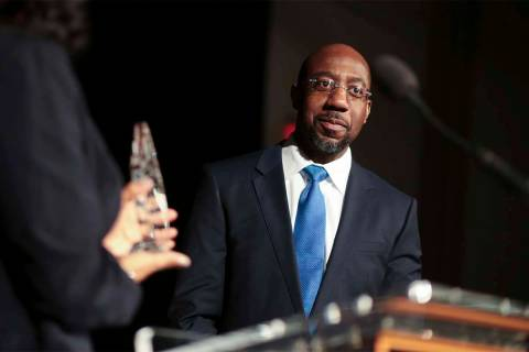 "Pastor Raphael Gamaliel Warnock, of Ebenezer Baptist Church, receives a ""President's Fulfilling ..."