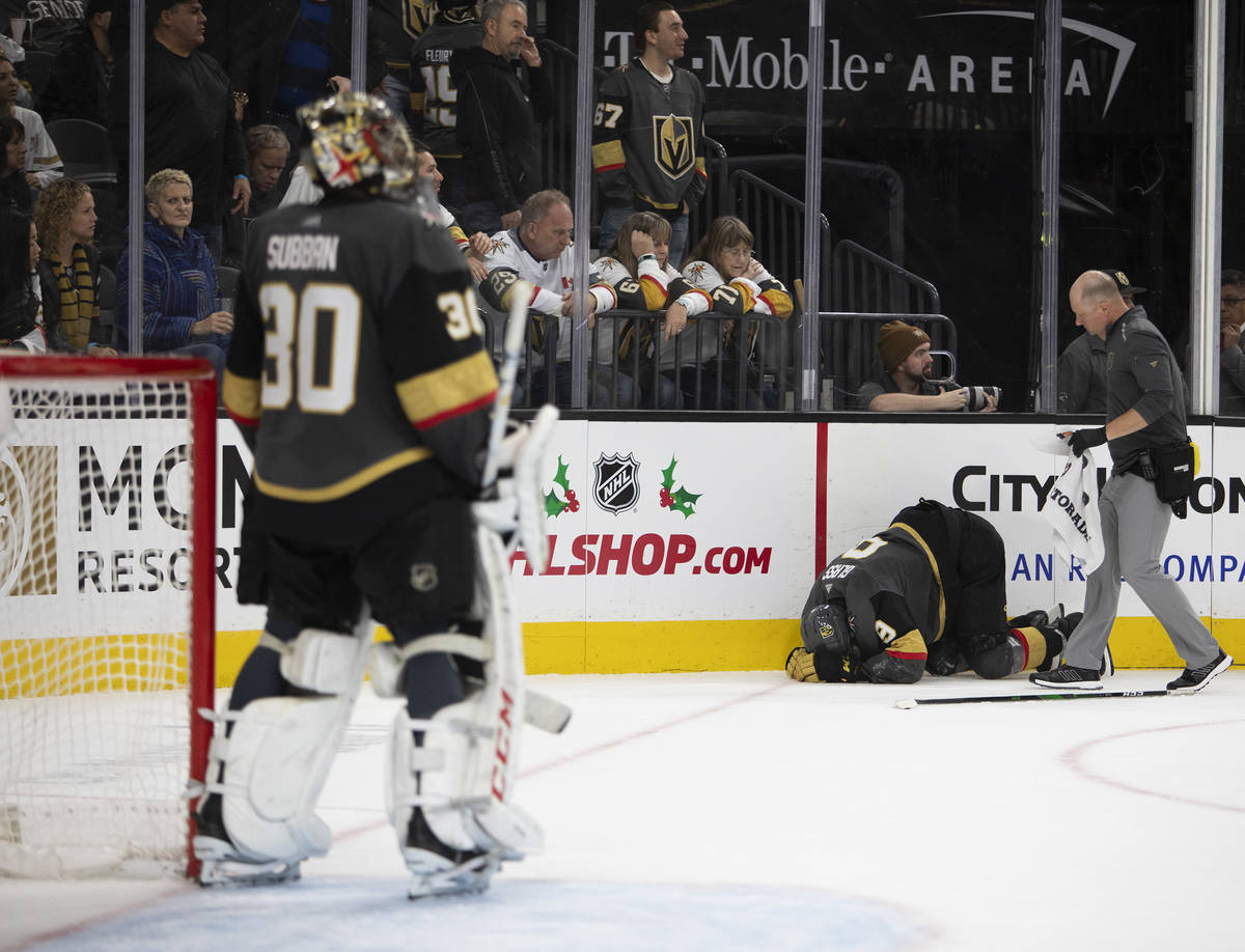 Vegas Golden Knights center Cody Glass (9) crouches in pain during the second period of the gam ...
