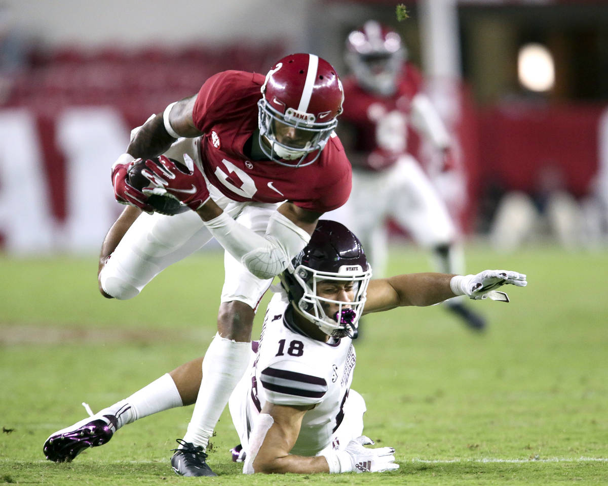 Alabama defensive back Patrick Surtain II (2) makes an interception that he returned for a touc ...