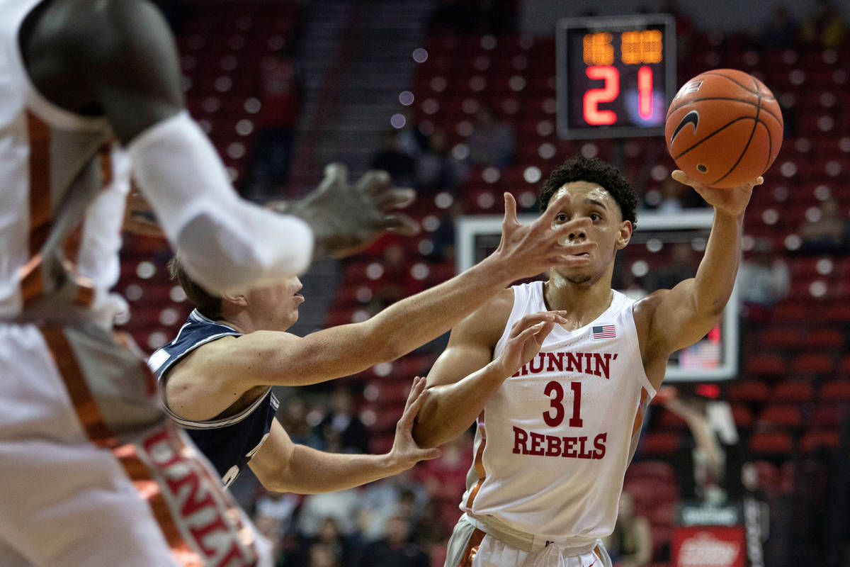 UNLV's guard Marvin Coleman (31) looks to pass to a teammate during the first half of the game ...