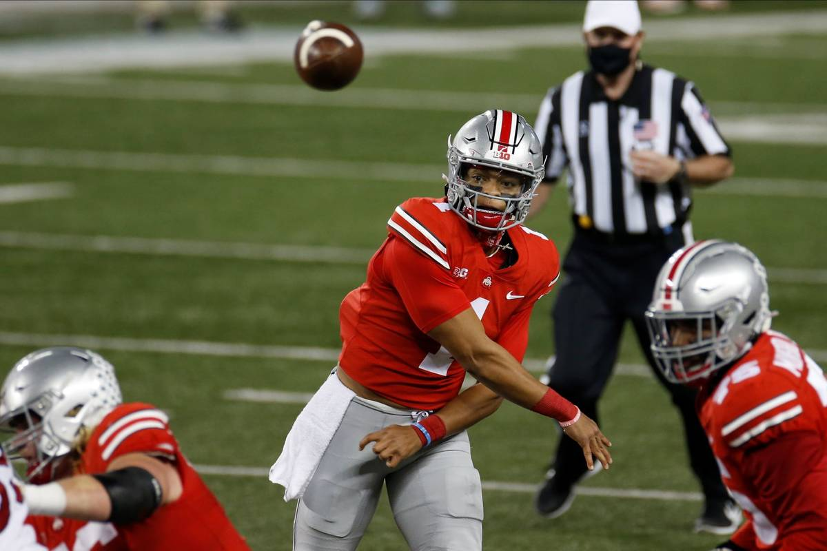 Ohio State quarterback Justin Fields throws a pass against Rutgers during the first half of an ...