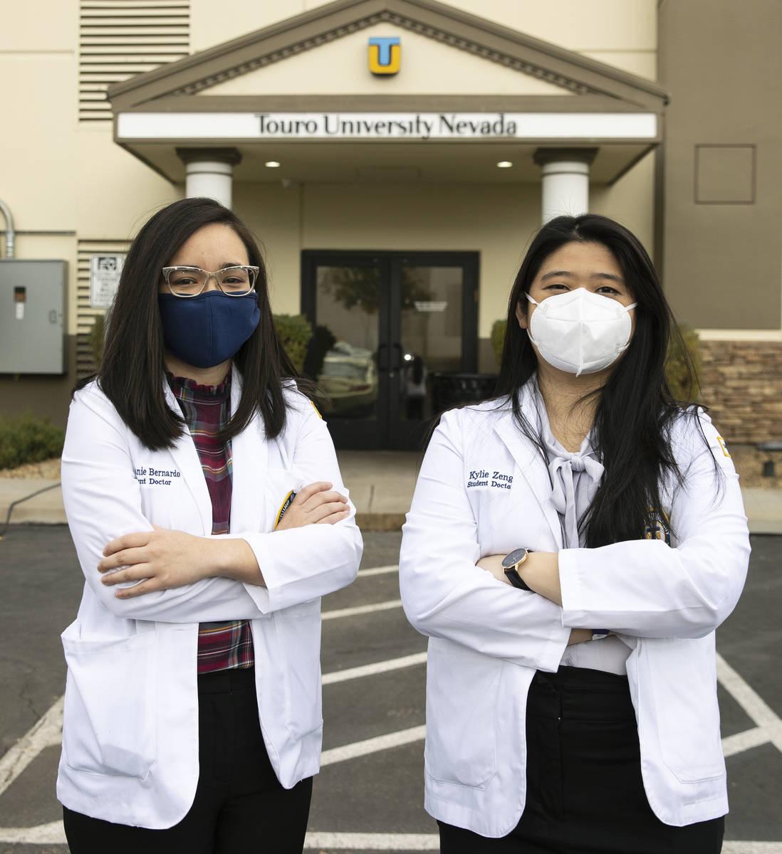 Toro University Nevada students, Stephanie Bernardo, left, and Kylie Zeng pose for a photo, on ...