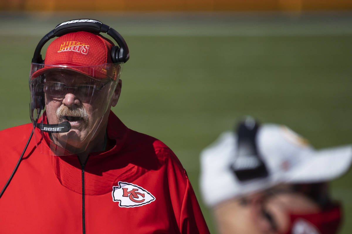 Kansas City Chiefs head coach Andy Reid, left, walks the sideline in the second quarter during ...