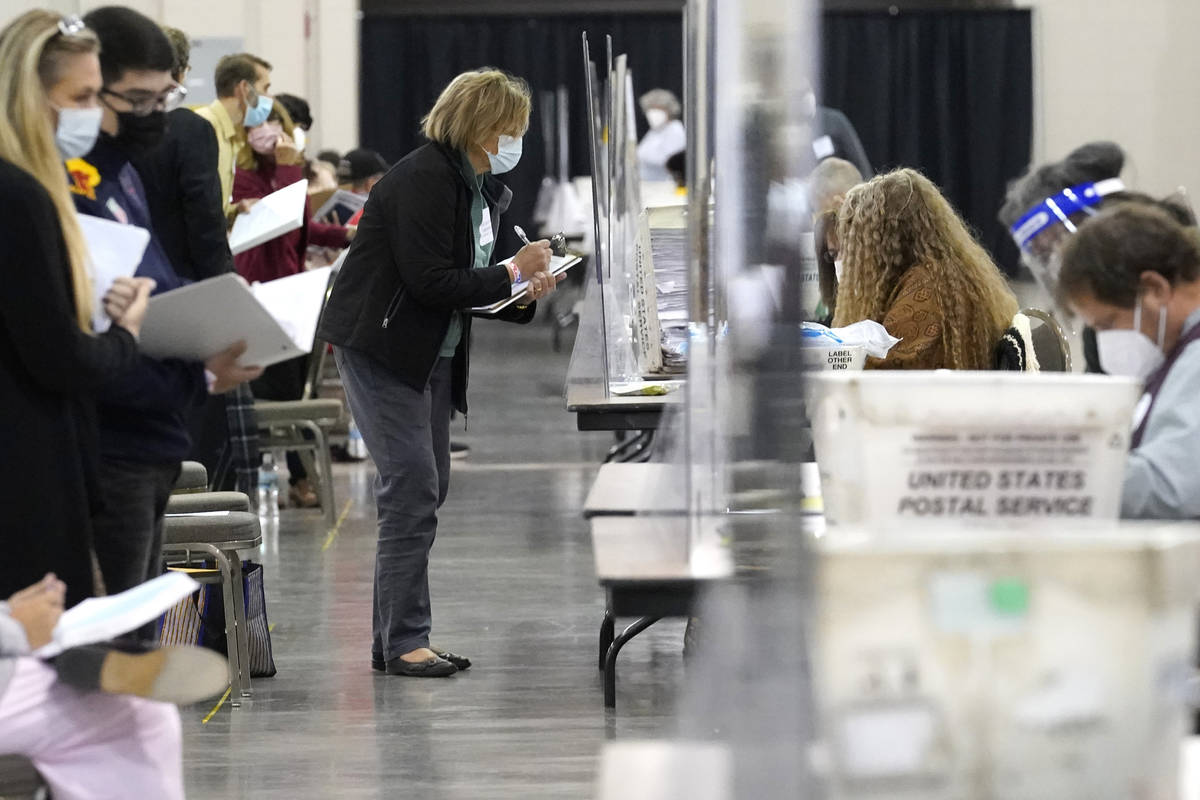 Recount observers watch ballots during a Milwaukee hand recount of Presidential votes at the Wi ...