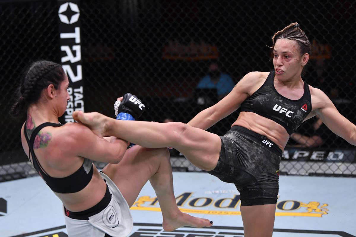 LAS VEGAS, NEVADA - NOVEMBER 21: (R-L) Antonina Shevchenko of Kyrgyzstan kicks Ariane Lipski o ...