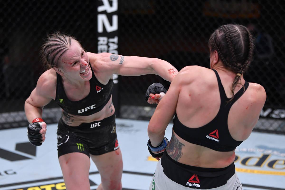 LAS VEGAS, NEVADA - NOVEMBER 21: (L-R) Valentina Shevchenko of Kyrgyzstan punches Jennifer Mai ...