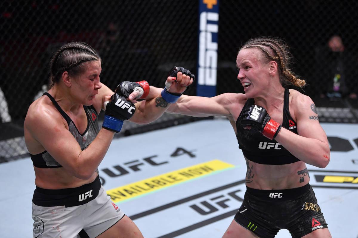 LAS VEGAS, NEVADA - NOVEMBER 21: (R-L) Valentina Shevchenko of Kyrgyzstan punches Jennifer Mai ...