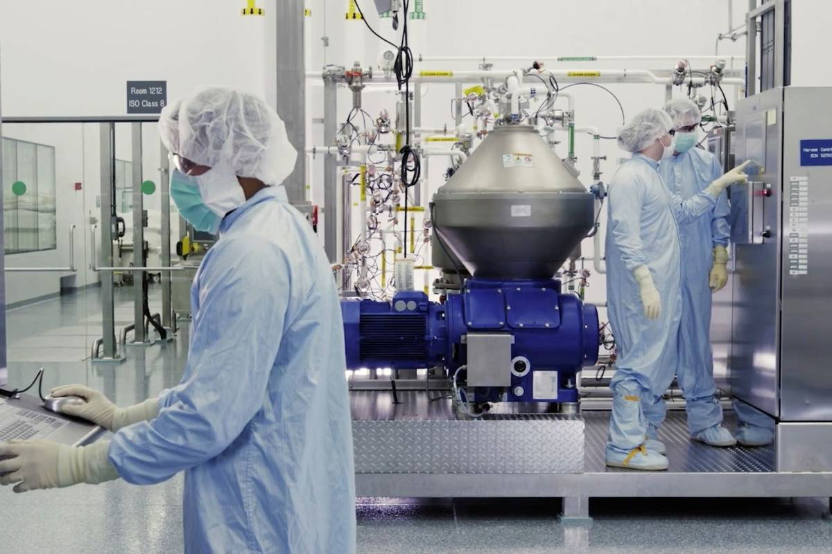 Scientists work with a bioreactor at a company facility in New York state for efforts on an exp ...