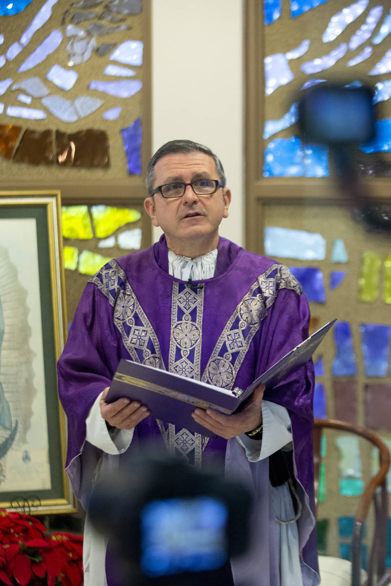 Cameras record Msgr. Gregory Gordon giving a virtual Mass at the The Roman Catholic Diocese of ...