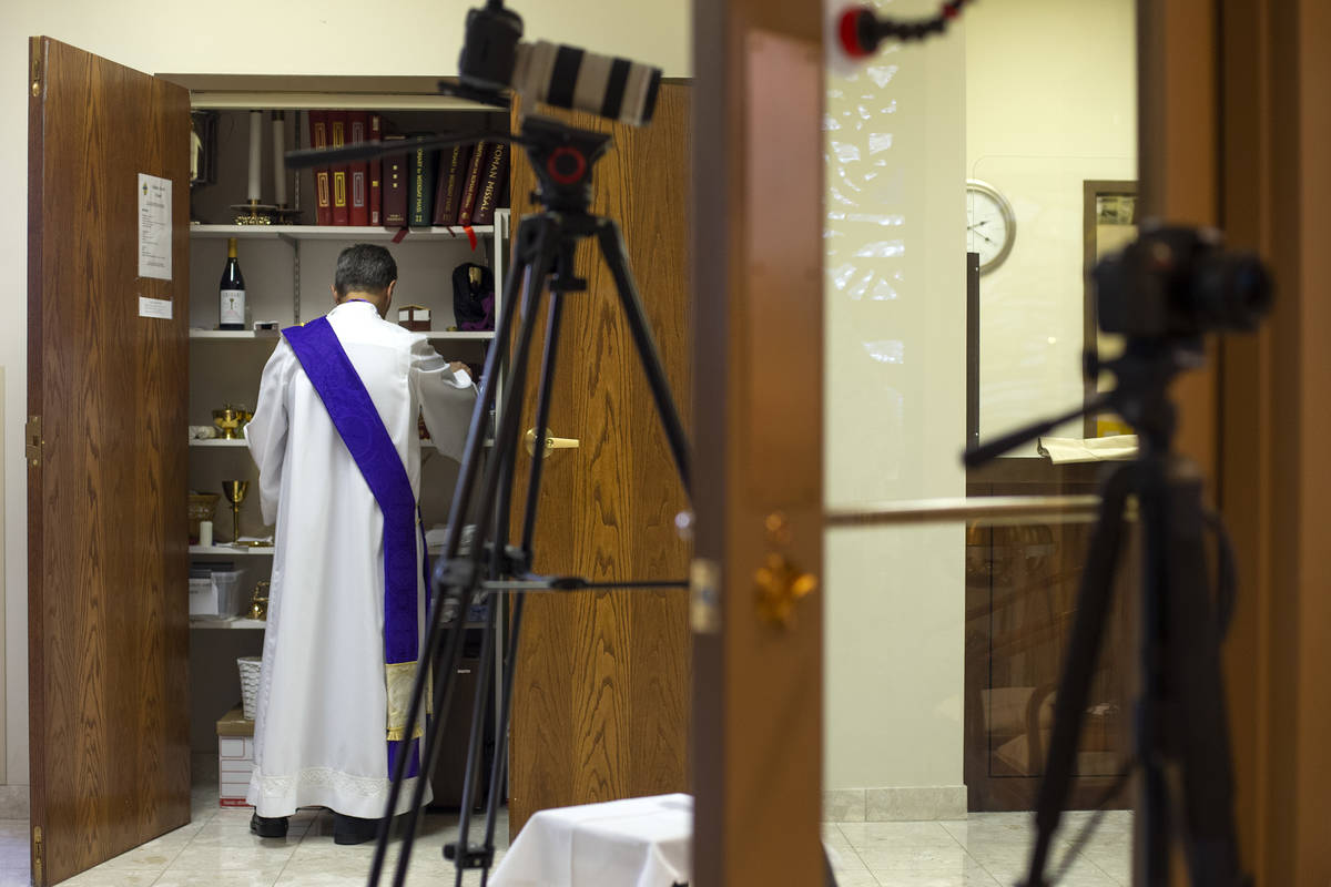 Deacon Rick Minch readies for a virtual Mass at the The Roman Catholic Diocese of Las Vegas on ...