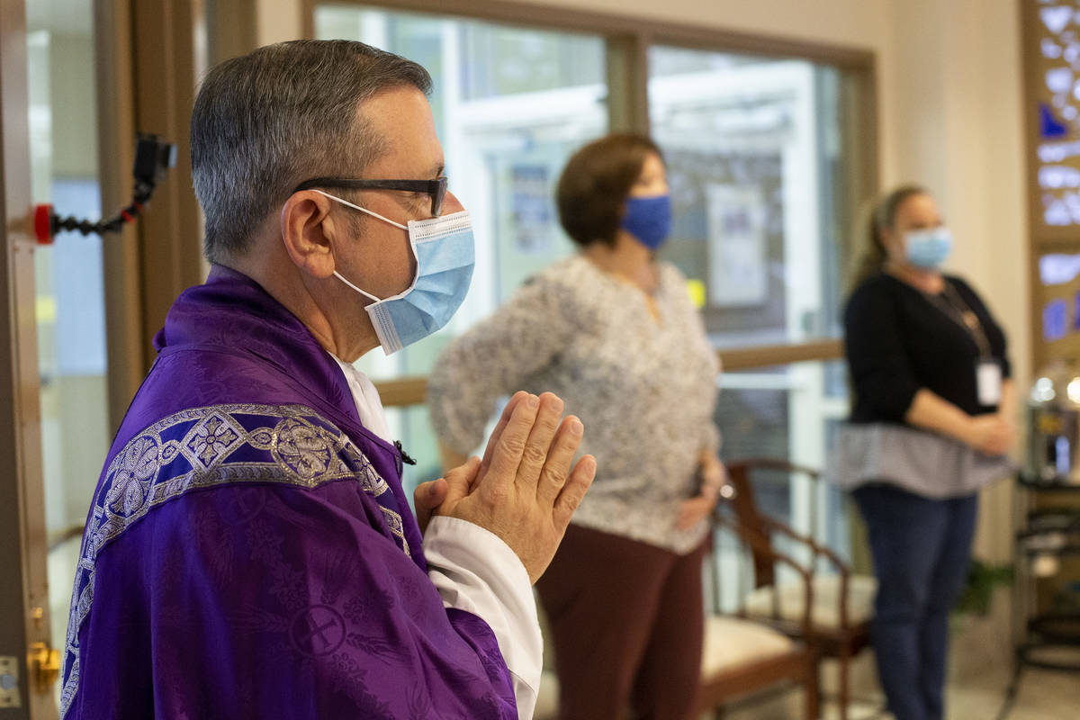 Msgr. Gregory Gordon enters the room to begin a virtual Mass at the The Roman Catholic Diocese ...