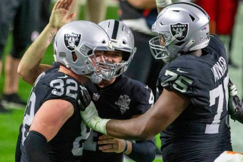 Las Vegas Raiders tight end Jason Witten (82) celebrates his touchdown score with quarterback D ...