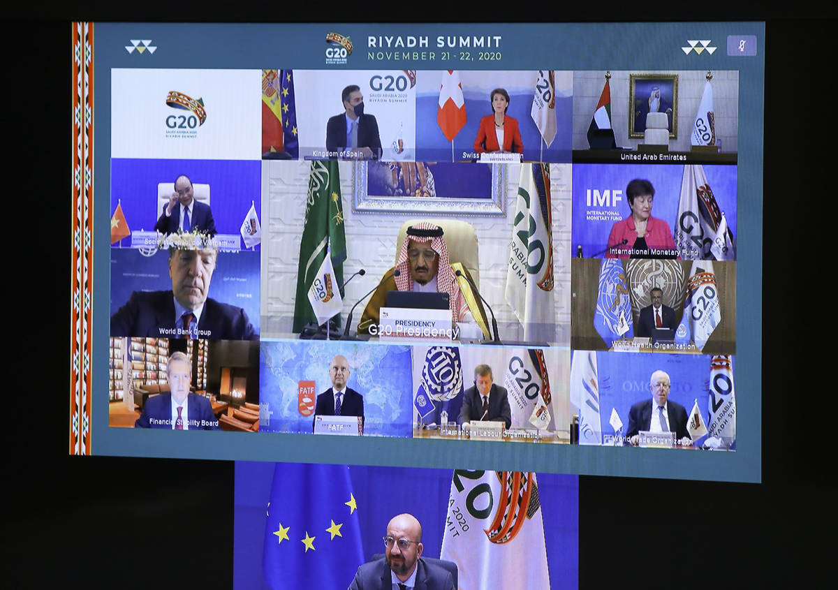 European Council President Charles Michel, on screen bottom, participates in a virtual G20 meet ...
