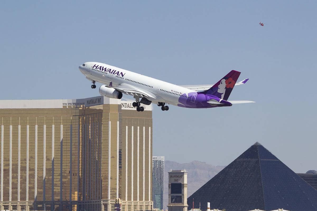A Hawaiian Airlines jetliner departs from McCarran International Airport in Las Vegas in this J ...