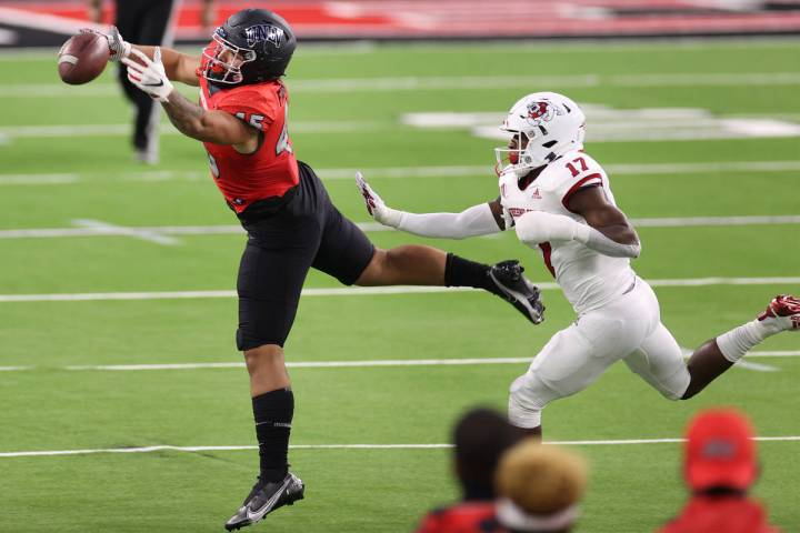 UNLV Rebels tight end Giovanni Fauolo Sr. (45) misses a catch under pressure from Fresno State ...